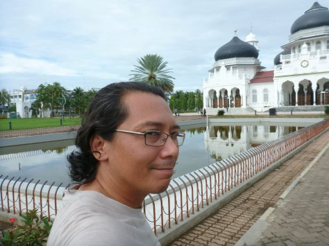 me lah in front of the mosque